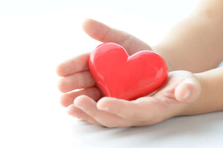 Children's hands with heart objects Stockfoto