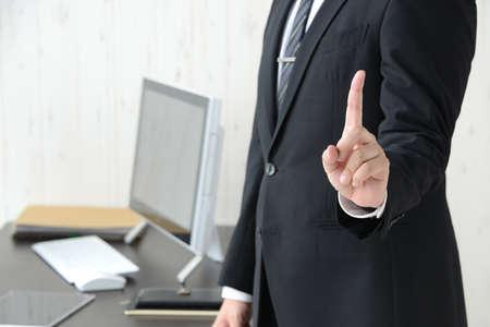 Businessman raised his index finger Banque d'images