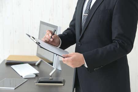 a businessman who checks documents Banque d'images - 153856649