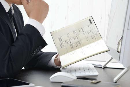 Businessmen checking the schedule