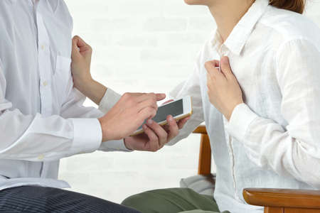 A man who contacts a woman who complains of poor physical condition with a smartphone