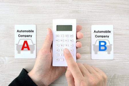 Choosing an automobile manufacturer 免版税图像