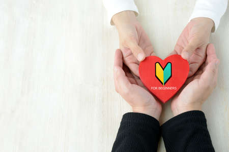 Couple hands with heart objects marked with beginner marks