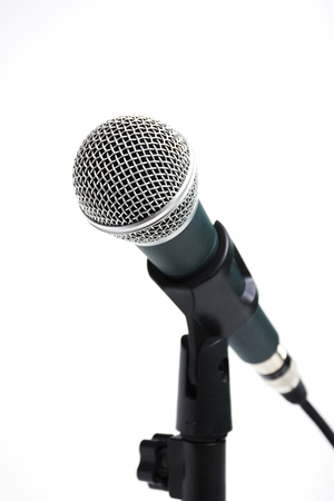 closeup a microphone on stand isolated on white background