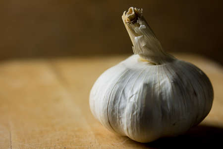 Garlic bulb in the vintage background, rural lifestyle concept.