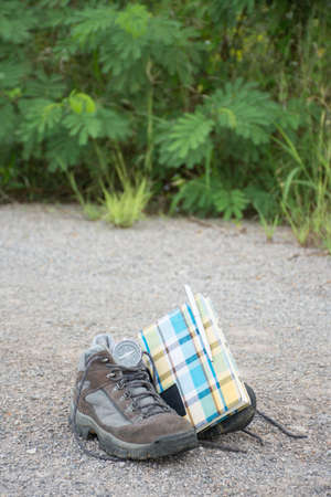 Old shoes compass and Travel memo. On the road, vintage style. Banco de Imagens