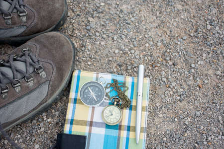 Old shoes pocket watch and compass. On the road, vintage style.
