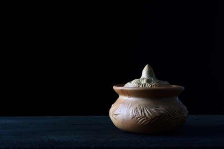 Pottery pots placed on a dark background.