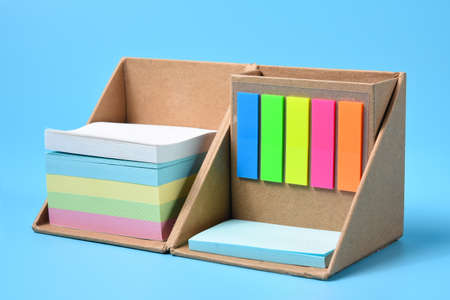 colorful sticky post in box isolated on blue background.