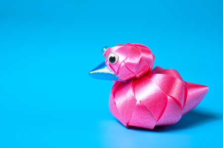 Pink hand-made duck ribbon as a gift for Christmas and New Year, wedding and birthday.