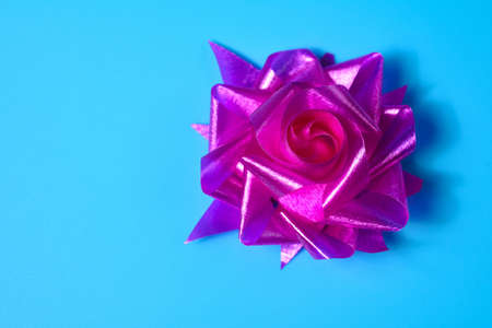 Pink hand-made rose ribbon as a gift for Christmas and New Year, wedding and birthday. Banco de Imagens