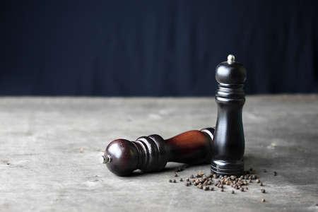 pepper mill on wooden table. still life concept. Banco de Imagens