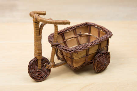Toy wood Tricycle On a wooden background Banco de Imagens