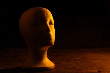 Polystyrene foam head, blazing with orange light.