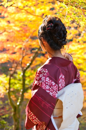 beautiful japanese kimono woman and red leaves in autumn Stock Photo