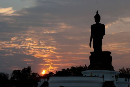 silhouette of big buddha statue with beautiful sun set at Phutthamonthon, Nakhon Pathom, Thailand Stock Photo - 14573919