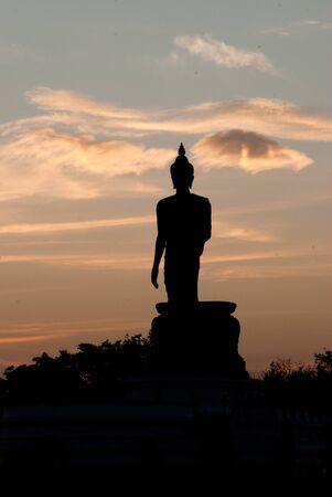 thaiart: silhouette of big buddha statue with beautiful cloud at Phutthamonthon, Nakhon Pathom, Thailand