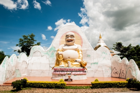 thaiart: Happy buddha with blue sky background