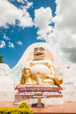 Happy buddha with blue sky background photo