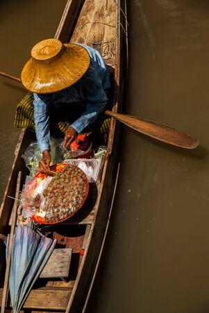 floating market: Merchant in floating market Stock Photo