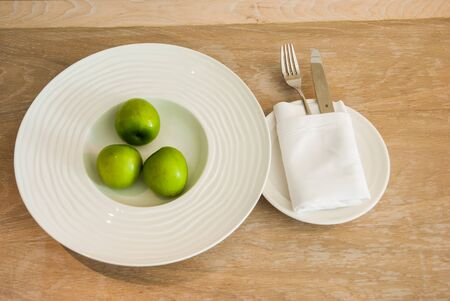Prepare jujube in the white plate on the wooden table photo