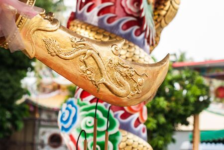 halberd: Golden halberd in hand of Chinese God  Guan Yu  statue in Sriracha, Chonburi, Thailan Stock Photo