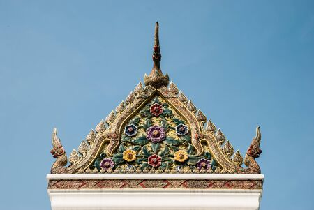 A gable of shrine in the city pillar shrine, Bangkok, Thailand photo
