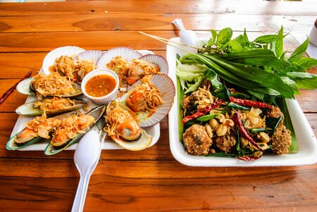 Thai dish from floating market   Larb-Moo-Tod and Seared scallop  photo