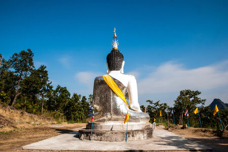 Behind of Buddha statue in clear sky backgroud photo