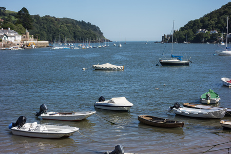 devon: The entrance to the River Dart, Devon, England with boats moored in the foreground  Stock Photo