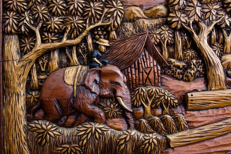 wood carving: Carved Elephant and Timbers Stock Photo