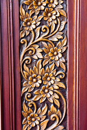 teak wood: Wood Carving of Flowers and Leaves  Stock Photo