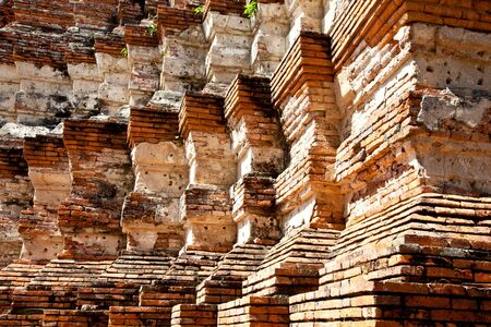 the repetition of brick pattern at the pagoda in wat chai wattanara, ayuthaya, thailand photo