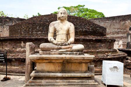 ancient seated buddha in valtadage, polonnaruwa, sri lanka photo