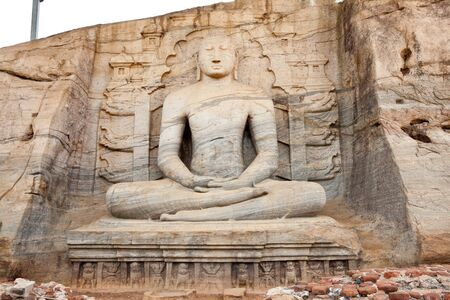 polonnaruwa: ancient seated buddha in gal vihara, polonnaruwa, sri lanka