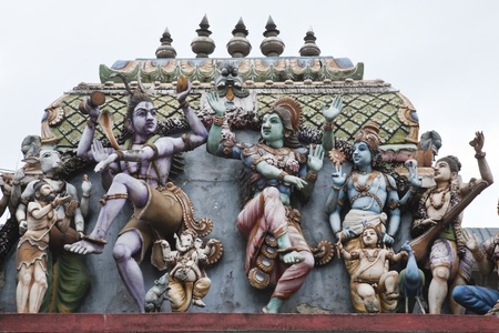 vishnu: gods and goddesses on the roof of hindu temple, sri lanka
