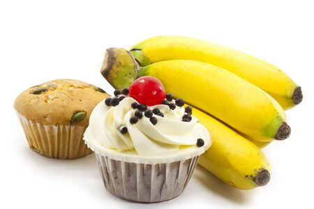 cup cake and bunch of bananas on white background photo