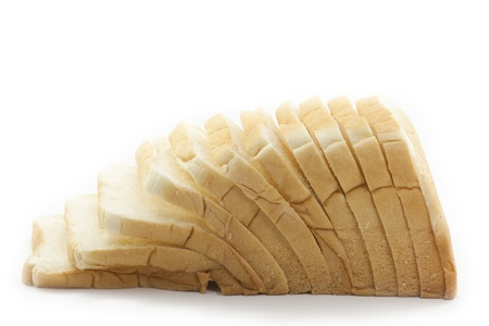 several slices of bread on white background photo