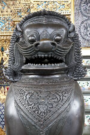 the face of singha statue in emerald buddha temple, bangkok, thailand photo