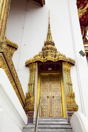 elaborate: elaborate temple doorway in wat phra kaew, bangkok, thailand