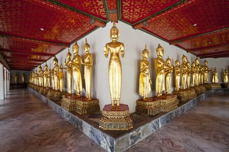 row of buddha image in wat pho, bangkok, thailand photo