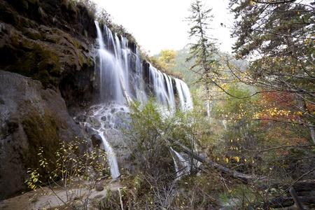 nuorilang waterfalls in jiuzhaigou national park, china photo