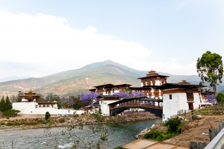 bhutan: punakha dzong with wooden cantilever bridge, bhutan