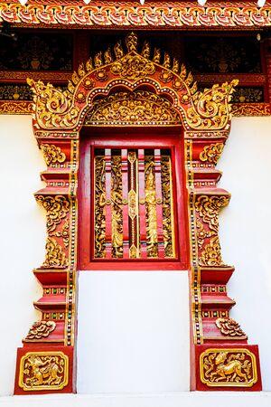 decoration on lanna style temple window, thailand photo