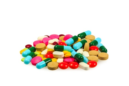 A pile of various pills on white background photo