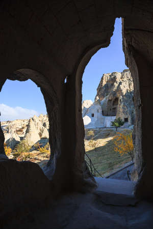 View of fairy chimney rock formation in cappadocia from rock cave