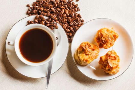 scone: Scone bread and a cup of coffee on white plate Stock Photo