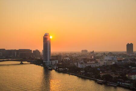 transportaion: Sunset at the Chao Phraya River in Bangkok, Thailand Stock Photo