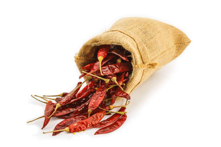 Dried chili in a sac on white background