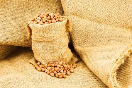 sac: Peanuts in a ramie sac Stock Photo